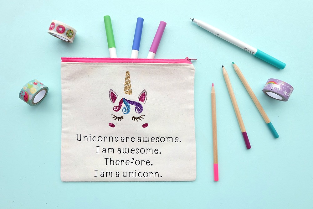 "This DIY ""Unicorns are awesome. I am awesome. Therefore, I am a unicorn."" pencil pouch is just as cute as can be. Includes a step by step sewing tutorial with photos. Would make an adorable makeup bag, pencil pouch or wallet for holding all your treasures in your purse! The perfect handmade gift idea for Christmas or birthdays for the unicorn lover on your list! A fun and easy Cricut Maker project! #Sponsored #Craft #diy #cricutmaker"