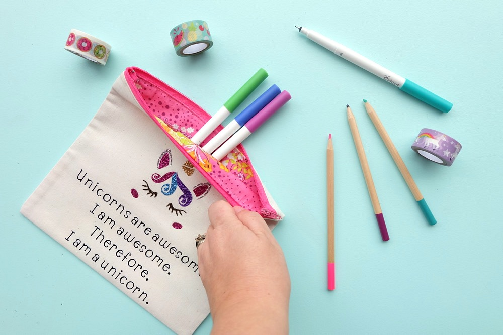 """This DIY """"Unicorns are awesome. I am awesome. Therefore, I am a unicorn."""" pencil pouch is just as cute as can be. Includes a step by step sewing tutorial with photos. Would make an adorable makeup bag, pencil pouch or wallet for holding all your treasures in your purse! The perfect handmade gift idea for Christmas or birthdays for the unicorn lover on your list! A fun and easy Cricut Maker project! #Sponsored #Craft #diy #cricutmaker"""