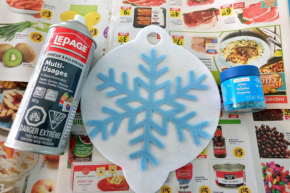"The new Cricut Maker cuts felt like butter! Learn how to make this DIY ""Joy"" Felt Winter Door Decoration in this no sew project that's perfect for a front door Christmas wreath substitute! How pretty are the sparkle snowflakes? #CricutMade #CricutHoliday #ChristmasCrafts #sponsored"