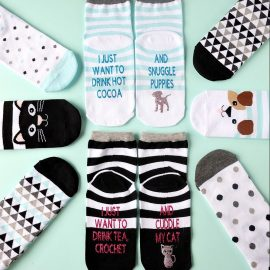 "The perfect handmade gift idea for dog and cat lovers! These DIY dog and cat themed ""If You Can Read This Socks"" are easy to make using a Cricut Maker or Cricut Explore and turn out so cute! Change the wording using our free Cricut Cut File! This is an adorable stocking stuffer idea under $5.00! Perfect for Easter Basket Stuffers too! #cricutmaker #cricutmade #cricutproject #stockingstuffer"