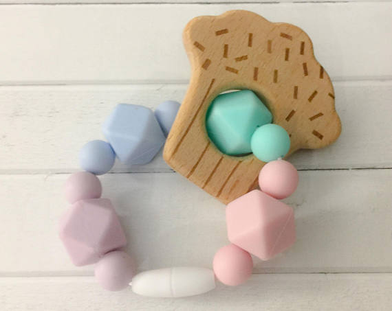 Handmade Holiday Gift Guide Gifts For Kids: Wooden Cupcake and Silicone Bead Teething Toy from Tesla Baby