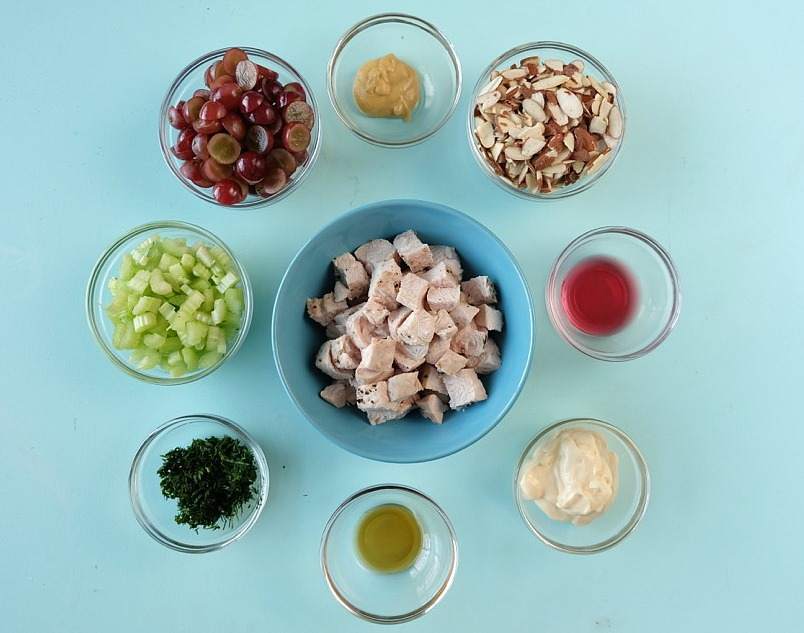 Your family is going to love this Napa Valley Turkey Salad Recipe! Whip up a big batch on meal planning days for easy lunches during the week. Creamy and slightly sweet with a great crunch from the almonds and celery this is a family favorite. Turkey salad sandwiches, wraps, and croissants are a few of our favorite ways to eat this recipe. For an extra healthy twist put your Napa Valley Turkey Salad in a bell pepper cup! #Recipe #lunch #mealplanning #sponsored