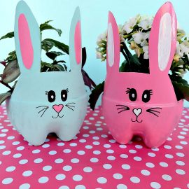 These DIY Easter Bunny Planters are made using recycled pop bottles! Bright and colorful they are a fun craft for a table centerpiece, front porch or handmade Easter gift idea! An easy upcycled kids Easter Craft to keep little ones occupied during spring break and to teach gardening skills. #Easter #Crafts #Upcycled HandmadeGift #Gardening