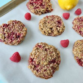 Looking for a delicious, easy and healthy breakfast idea? This healthy lemon raspberry breakfast cookie recipe is a delicious and guilt free way to start the day! Perfect for breakfast on the go, its gluten free, low in sugar, dairy free and packed with the bright and beautiful flavors of lemon and raspberries! Freeze extras for breakfast meal planning! #glutenfree #recipe #breakfast #cookie