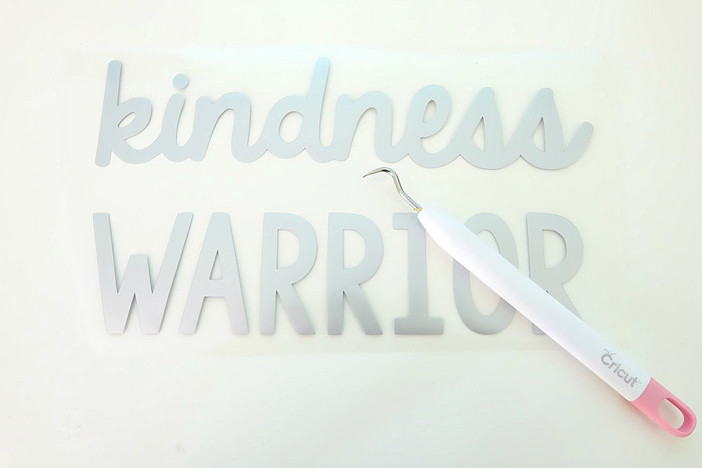 The world needs more kindness! Let's create an army of kindness with this easy to make DIY Kindness Warrior Shirt. Includes step by step instructions on how to make this project using a Cricut, along with a free SVG file compatible with Cricut or Silhouette. The perfect hoodie for kids or adults to spread love instead of hate, discourage bullying and make the world a better place. #DIY #Cricut #Silhouette #SVG