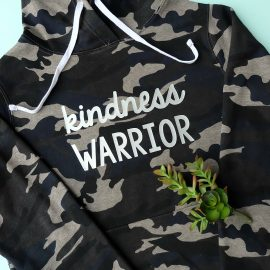 Spread kindness around the world! Let's create an army of kindness with this easy to make DIY Kindness Warrior Shirt. Includes step by step instructions on how to make this project using a Cricut, along with a free SVG cut file compatible with Cricut or Silhouette. The perfect hoodie for kids or adults to spread love instead of hate, discourage bullying and make the world a better place. #DIY #Cricut #Silhouette #SVG