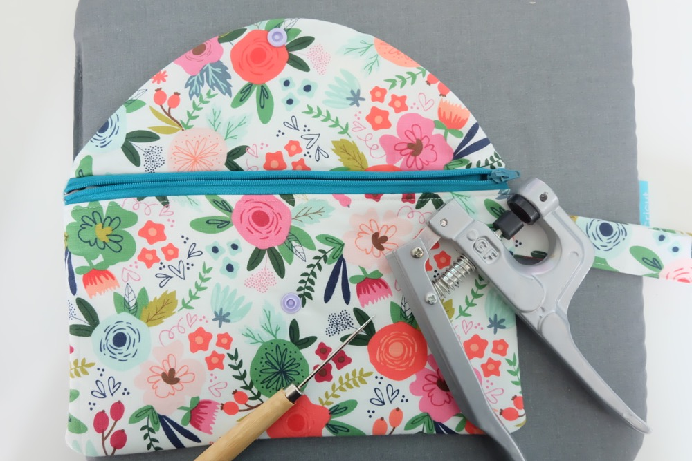 Every girl needs the perfect clutch, so why not make them! This easy sewing tutorial has step by step photos and instructions for making a DIY Wristlet Clutch Purse. Fit all of your essentials into this one little bag! Comes with a free cut file for making this craft project on the Cricut Maker. #Cricut #CricutMade #sewing #crafts