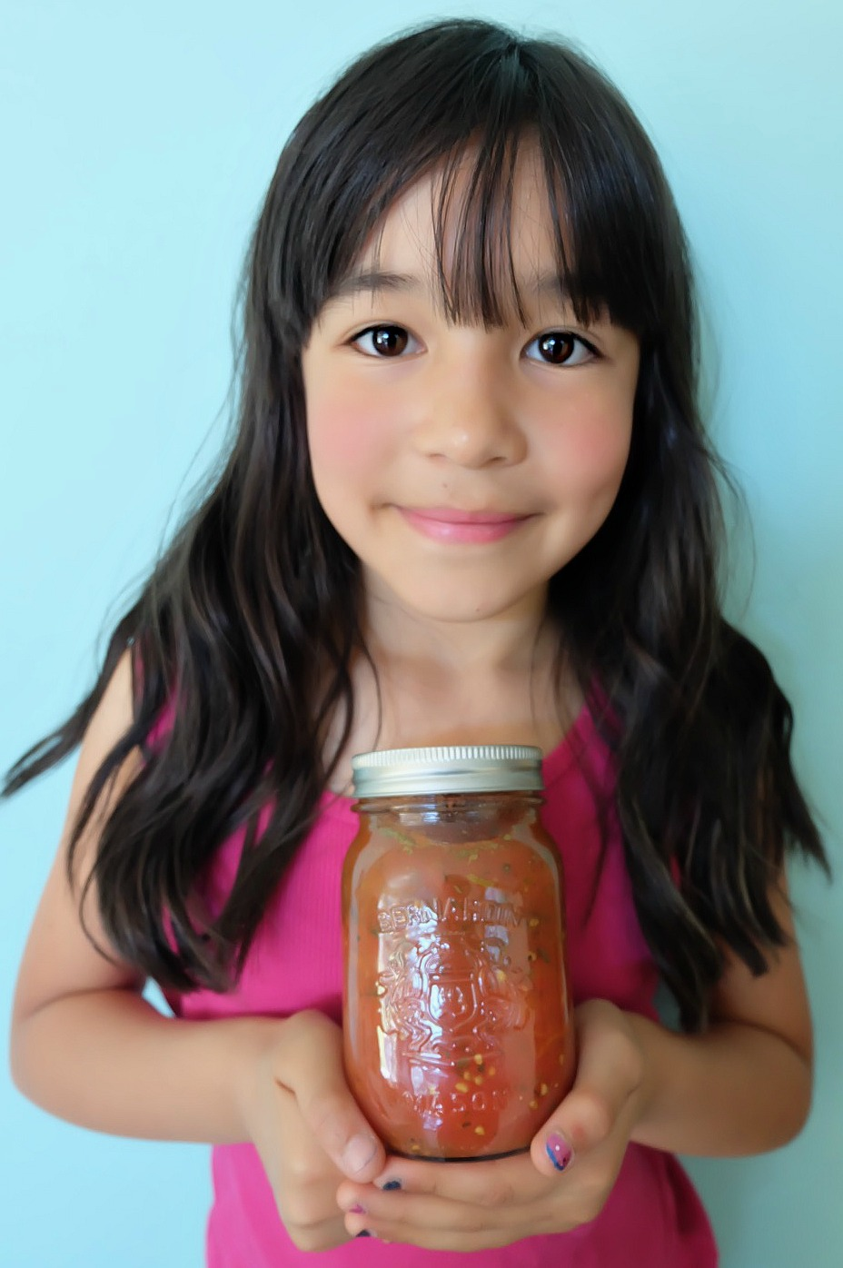 Get canning with your family this summer! We're sharing our top tips for canning with kids along with step by step photos and instructions for how to make our Easy Italian Herb Canned Tomatoes Recipe! We take all the intimidation out of canning so you can pass this handmade art along to your kids! #Canning #Recipe #Tomatoes #KidsCooking