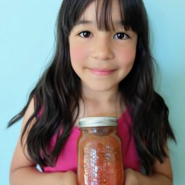 Canning can seem daunting if you've never tried it before, but we're here to make it super simple! We're sharing our top tips for canning with kids so that you can get started canning with your family this summer! Also find our recipe for Easy Italian Herb Canned Tomatoes with step by step photos and instructions for those new to canning and trying it for the first time! #Canning #FoodPreservation #Recipes #Tomatoes #CookingWithKids