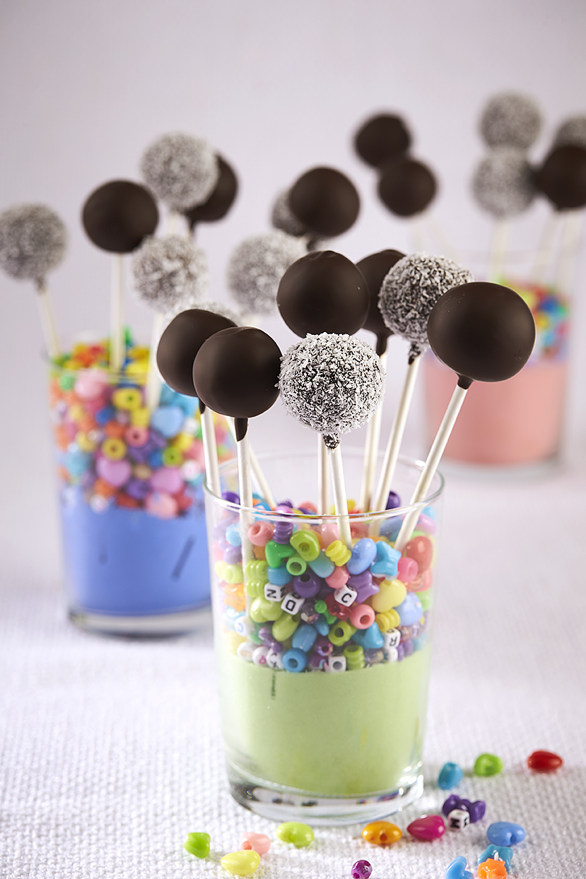 Looking for a delicious, nutritious, guilt free dessert idea? This Chocolate Chia Bliss Ball Pops Recipe is vegan, gluten-free and nut free! It's perfect for an easy, healthy birthday dessert idea and would be perfect for a nut-free school snack or treat! Recipe from the book The Wholesome Child. #Dessert #Recipe #GlutenFree #RealFood