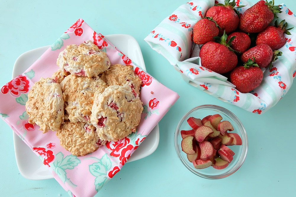 Strawberries, rhubarb, coconut and frothy egg whites come together in one delicious dessert in this Strawberry Rhubarb Coconut Meringue Cookie Recipe. These pretty cookies are perfect for a summer tea party and are simple to make. Sure to become a family favorite! #cookies #recipe #strawberry #rhubarb #strawberryrhubarb