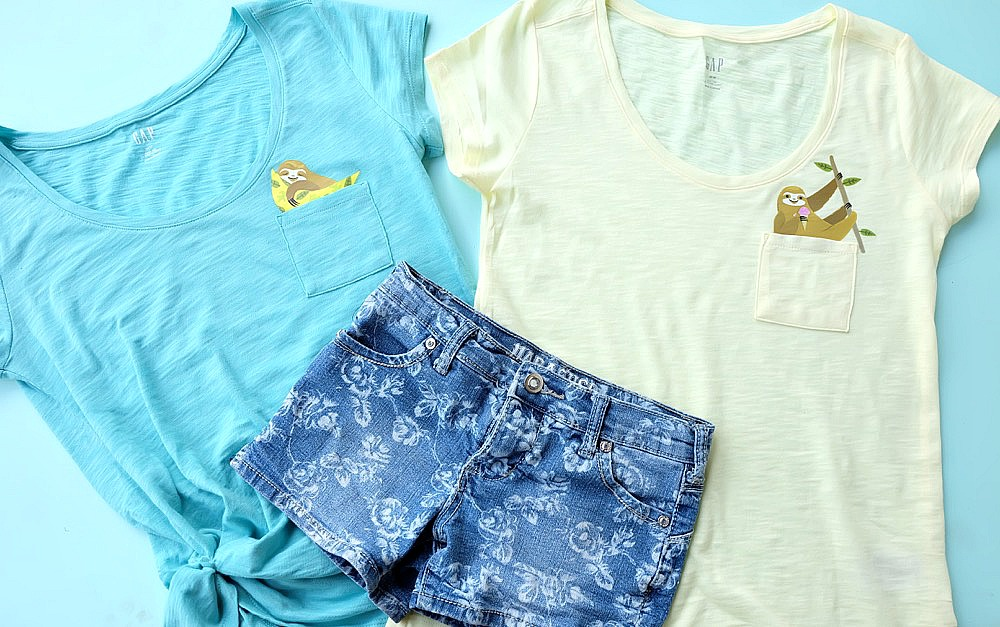 Super cute and easy to make, these DIY pocket animal shirts have an adorable sloth peeking out of the pocket! This craft project takes less than 5 minutes to make and is a great handmade gift! Perfect for back to school fashion, pocket shirts are the latest kids fashion trend! No cutting machine required! #DIY #Craft #KidsClothing #CricutMade