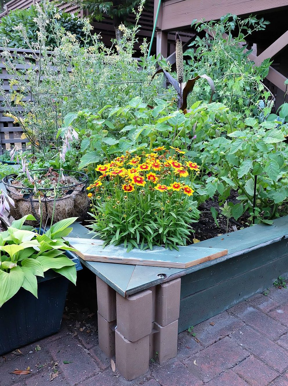 Expand your patio garden or backyard garden with this easy DIY planter box from Hello Creative Family. No power tools required, this planter box can be made in an hour or less in a small space, large space or any size in between. Includes step by step instructions. #Gardening #PatioGardening #SmallSpaceGardening #DIY