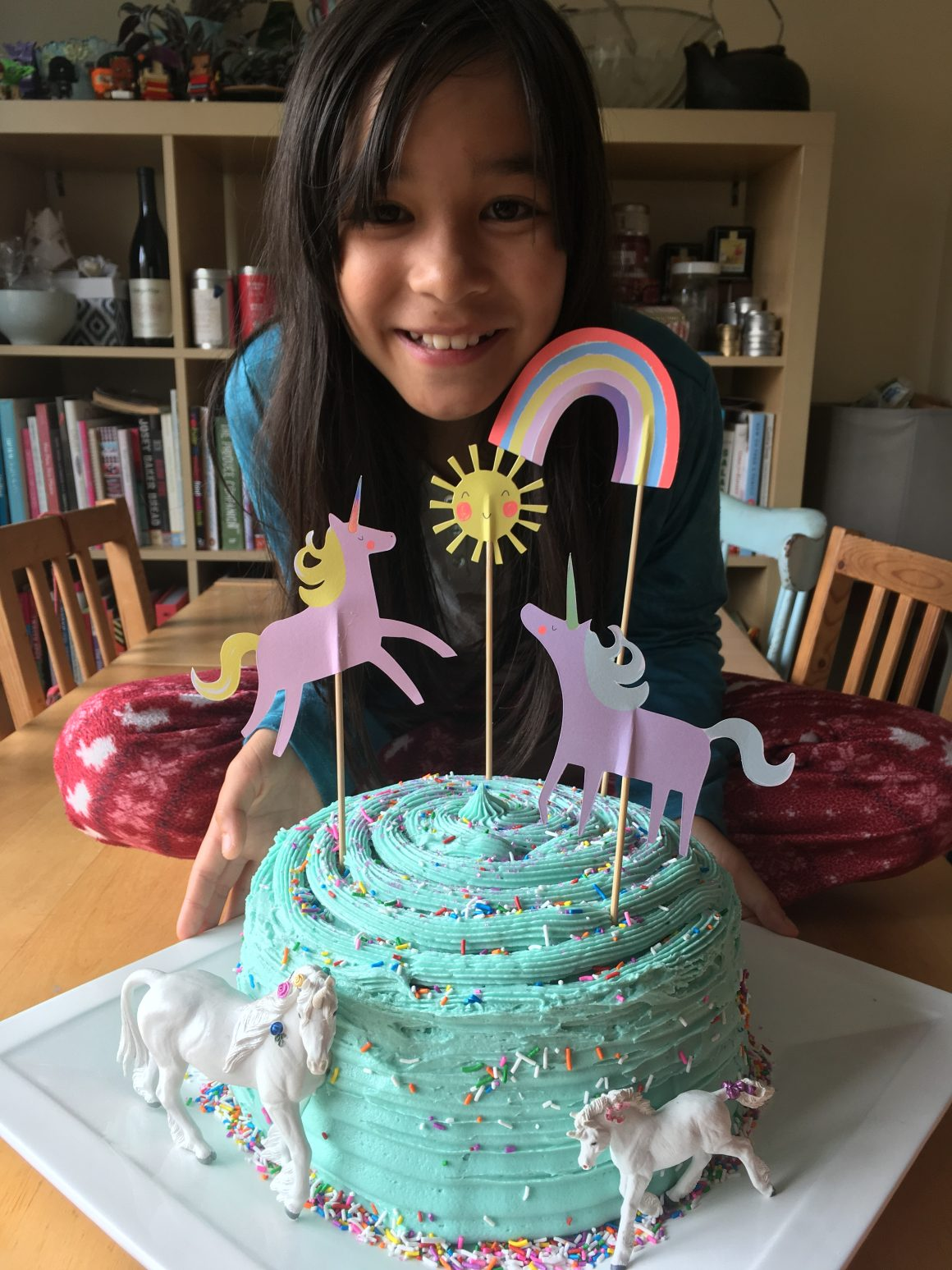 Simple unicorn birthday cake with a rainbow hidden inside.
