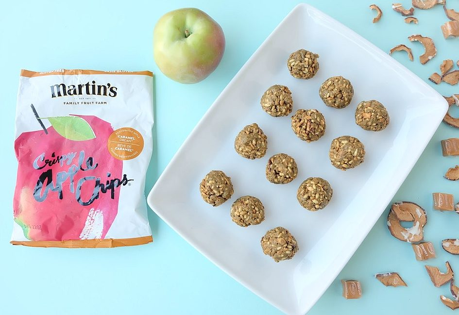 This caramel apple no bake energy bites recipe is delicious, nutritious and perfect for school lunches. It is nut free and easy to make in less than 5 minutes. Packed with protein these bliss balls are a family friendly snack idea. #Recipe #Apples #AppleRecipe #Sponsored