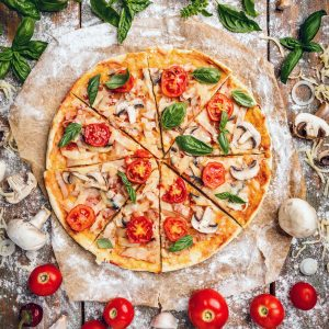 Looking for a delicious dinner idea? Try this 5 minute prep easy pizza dough recipe! Prep your dough in minutes and get the kids cooking with you rolling out there dough and picking their toppings! Makes a super yummy thin crust pizza that your whole family will love! #Recipes #Pizza #Easy #30minutemeal