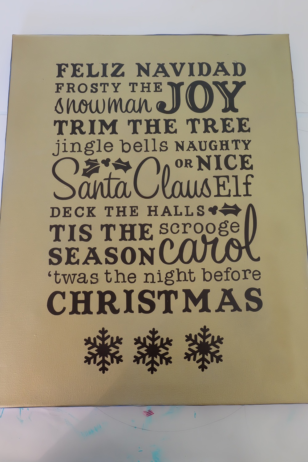 Use your Cricut Explore or Cricut Maker to make a gorgeous DIY Christmas Word Art Canvas Sign! Filled with all the words that make Christmas so special, this handmade Christmas decor will brighten any home! Made with a canvas you can find at the dollar store. This craft project would make a great inexpensive handmade Christmas Gift! #Cricut #CricutProject #DIY #Christmas #HandmadeChristmas