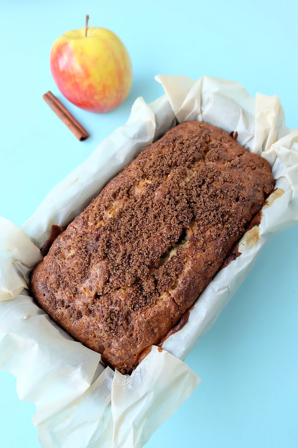This cinnamon apple bread recipe is a family favorite that is perfect for breakfast or a to serve for afternoon tea! Kid friendly, the apples melt right into the bread. Topped with a crunchy cinnamon and brown sugar topping. Easy to make with just 10 minutes of prep time, you're going to love baking this apple recipe! #Baking #Bread #Apples #Recipe