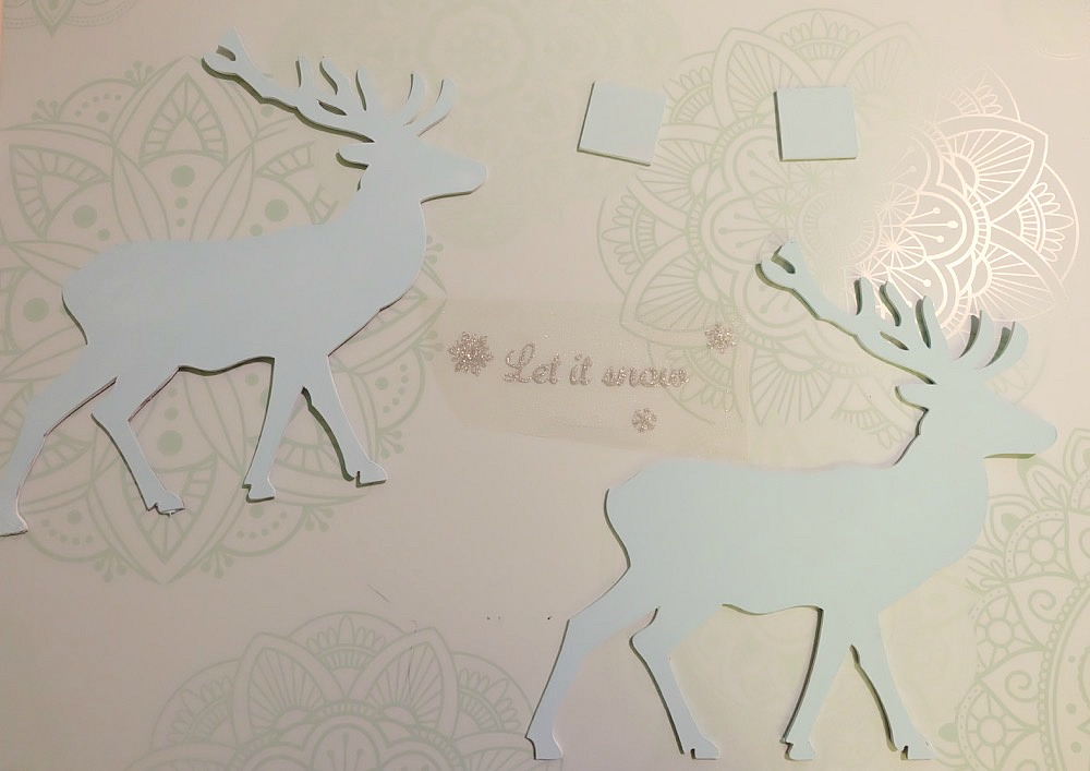 "This beautiful DIY reindeer Christmas Ornament is cut using the Cricut Maker! Decorated with ""Let It Snow"" it makes a beautiful handmade gift idea! This step by step tutorial with photos teaches you how to cut chipboard using your Cricut Maker to make beautiful home decor items. Make handmade reindeer decorations as teacher gifts, gifts for mom, or gifts for a friend. #HandmadeGift #CricutMaker #Christmas #Reindeer"