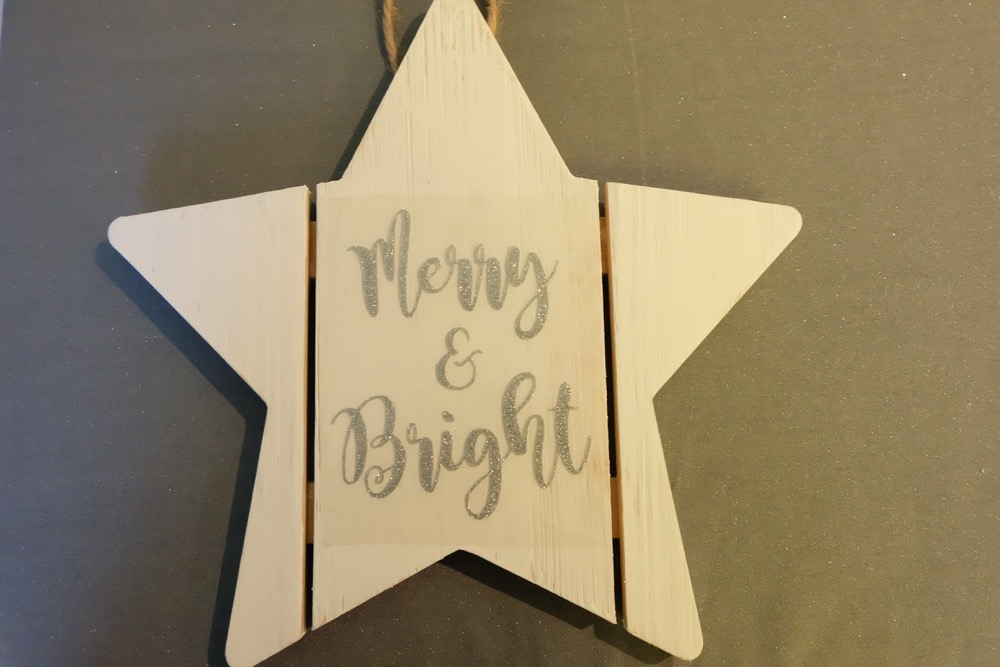 Find out how easy it is to turn an unfinished wood sign into a DIY Wood Christmas Sign with this awesome step by step tutorial. Includes a free Merry and Bright Christmas SVG file that you can cut using your Cricut or Silhouette to to make this beautiful quick handmade gift idea! Perfect for a DIY front door Christmas sign or to hang on a door handle or on the wall inside the house. Let the Christmas decorating begin! #Cricut #Silhouette #Christmas #WoodSign