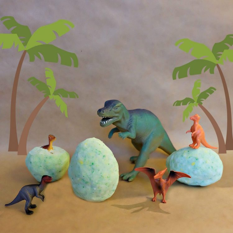 Bath bombs are easy to make at home, if you know how! Learn how to make these DIY Dinosaur Egg Bath Bombs. They have little toy dinosaurs hidden inside and make a great gift idea for dinosaur loving boys and girls! Give them as a handmade stocking stuffer and make bath time fun!#StockingStuffer #Handmade #DIY #Dinosaur #BathProduct