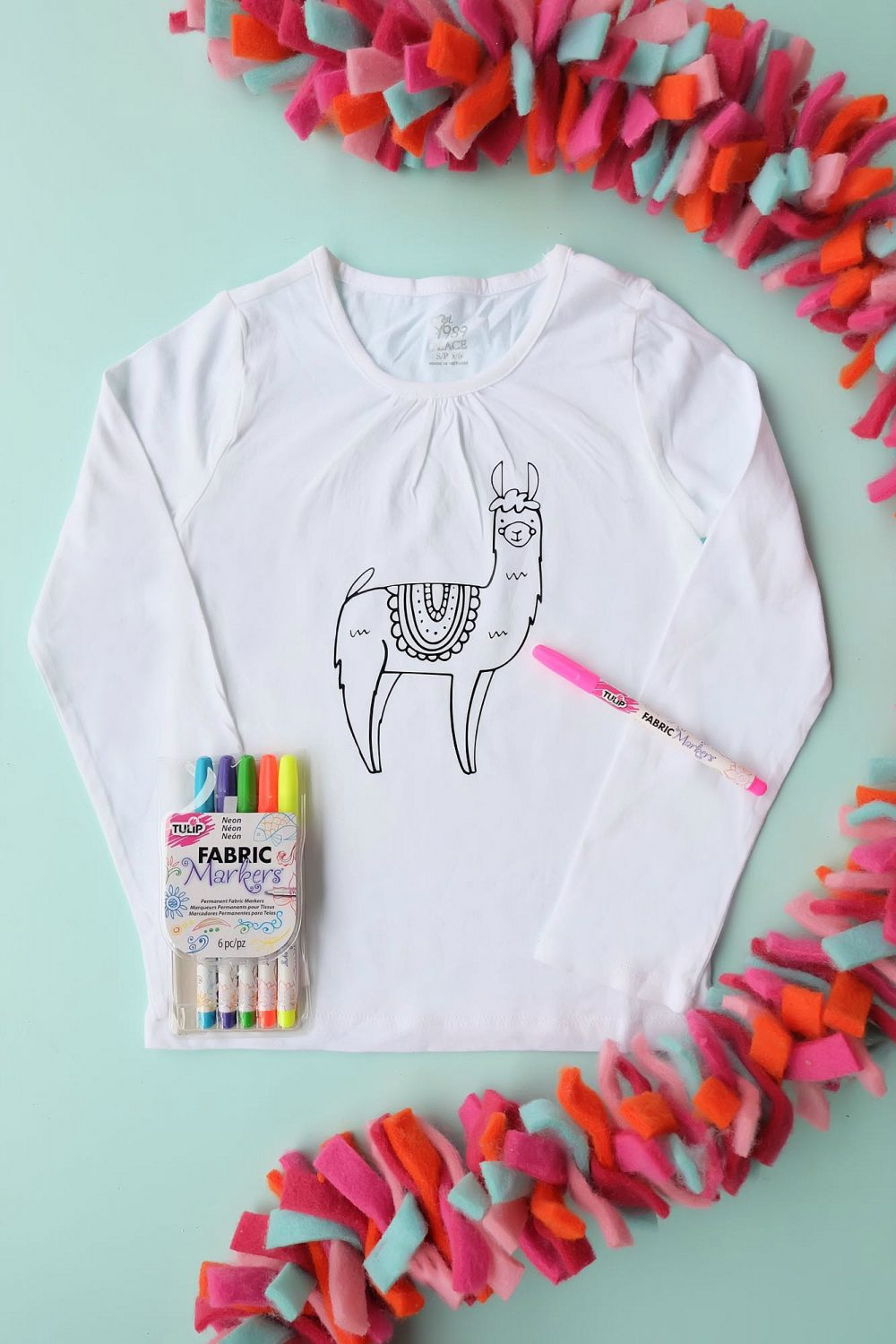 Are you in love with the llama crazy? We sure are! Make this Easy DIY Llama Coloring Shirt for a super fun handmade gift idea thats a kids craft and a piece of clothing in one! Cut using your Cricut Explore, Cricut Maker or Silhouette! #llamas #DIY #Cricut #Silhouette #Coloring
