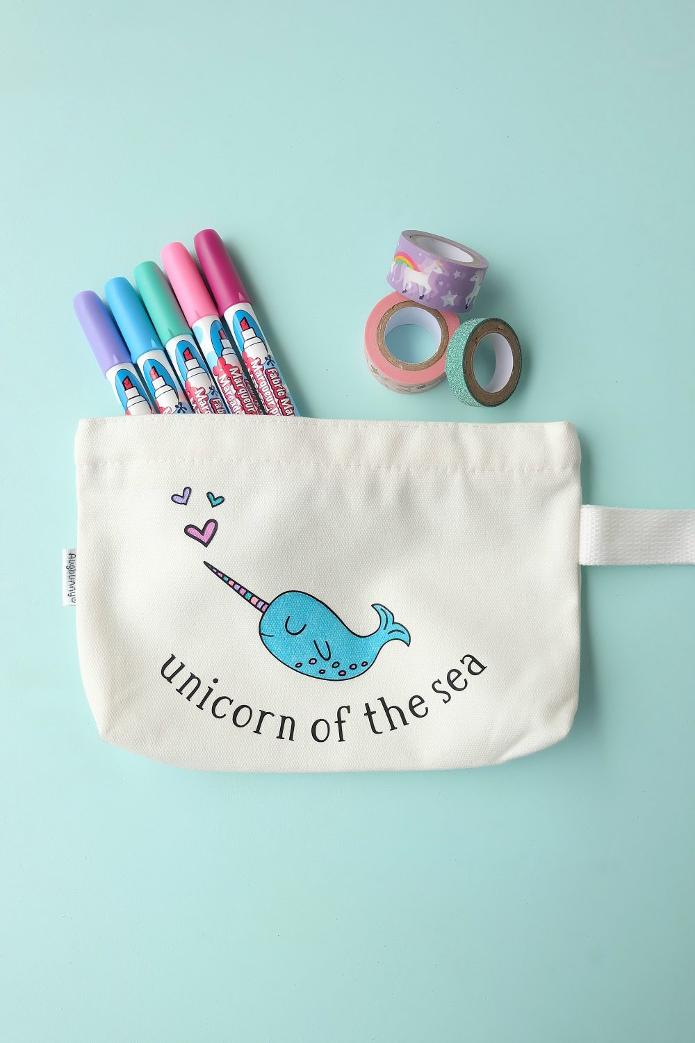 Create a sweet little DIY Narwhal Zippered Pouch that the recipient can color in! This thoughtful handmade gift takes only minutes to make and is a thoughtful handmade gift idea for kids (or adults!) It's a coloring sheet and a pencil pouch in one! #Cricut #Narwhal #DIY #Coloring