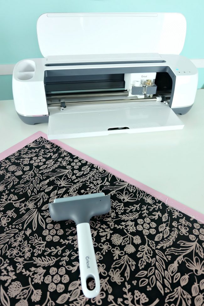 The Cricut Brayer is a great tool for anyone who does Cricut crafts! I love using it to apply fabric to my cutting mat and for applying heat transfer vinyl to shirts.