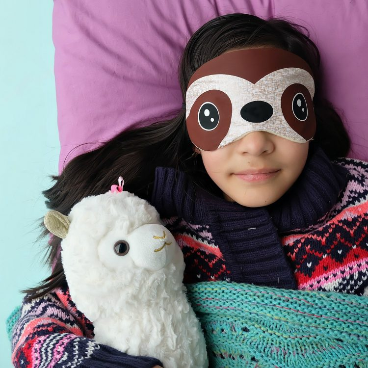 This might be the most fun Cricut Maker project ever! How adorable is this DIY Sloth Sleep Mask? This easy project only takes 15 minutes to make. Includes a step by step tutorial and cut file for cutting with your Cricut Maker or Cricut Explore! Would make adorable party favors for a sloth birthday slumber party! #Cricut #Sloth #Sewing #Craft