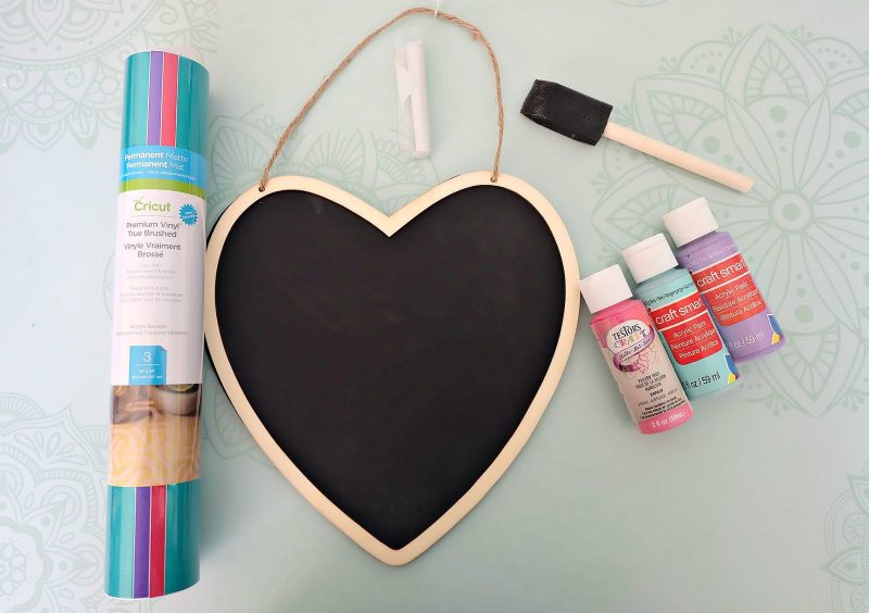 Make an adorable DIY Conversation Heart Sign using a wood sign from the dollar store, your Cricut or Silhouette and one of our 15 free Conversation Heart SVG Files! This easy craft is perfect for decorating for Valentines Day! #ValentinesDay #DIY #Cricut #DollarStoreCrafts