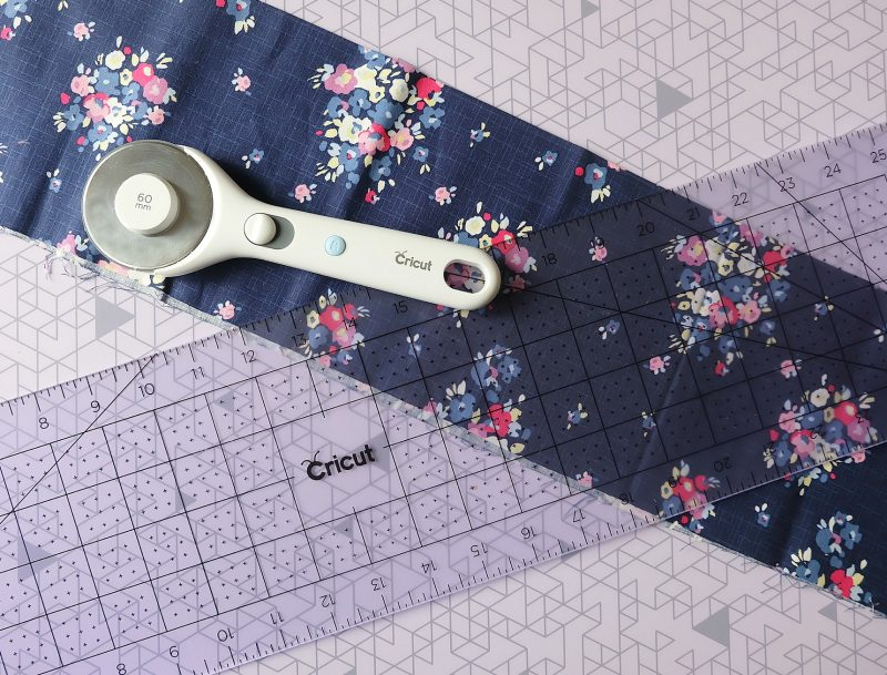 The Cricut Rotary Cutter, Self Healing Mat and Acrylic Ruler are sewing room essentials for every crafter! #Cricut #Sponsored #CraftRoom #CraftTools #sewing