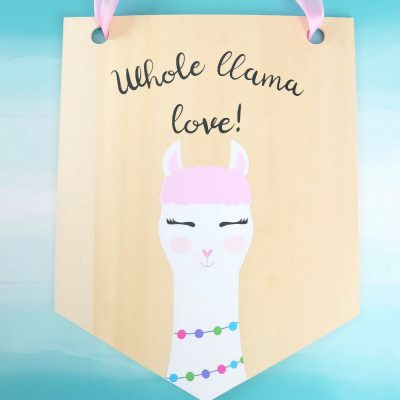 Learn how to cut basswood with your Cricut Maker and make this adorable DIY Llama Wood Wall Hanging featuring a cute Print and Cut llama and the quote Whole Llama Love. This craft would make a sweet handmade gift and would be perfect for decorating a girl's bedroom or as a fun front door decoration. Another amazing Cricut Project from Hello Creative Family. #CricutProject #handmade #llama #girlsroom