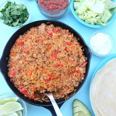 This quick and easy family friendly turkey and rice Mexican casserole recipe is a healthy one pan meal that takes 10 minutes to prep! Perfect for feeding a crowd or for multiple meals. Use it as a filling for tacos, burritos or as a topping for taco salad! #MakeItWithTurkey #Recipe #MexicanFood #Turkey #OnePan #sponsored