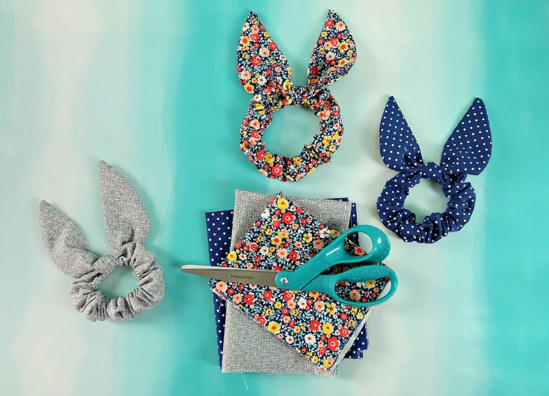 Some people call them a bunny ear scrunchy others a knot or bow scrunchy, whatever they are called, they sure are cute!. Sew one with our easy 10 minute sewing tutorial using our step by step instructions with photos and our free Cricut Maker SVG cut file! This quick and easy sewing project makes a great handmade gift! Perfect for Easter basket stuffers, stocking stuffers, presents for girls and party favors! #Sewing #EasySewing #CricutMaker #CricutMade