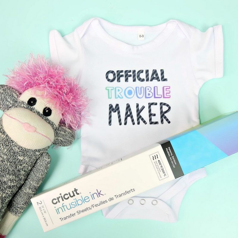 Learn how to use Cricut Infusible Ink to make this adorable DIY baby onesie! It's an easy craft idea that makes a super cute handmade baby gift! Includes step by step instructions for using Infusible Ink! #Ciricut #BabyShower #Handmade #InfusibleInk #CricutMade