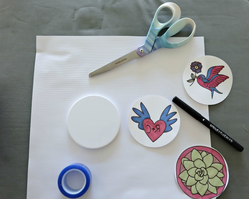 Make the cutest coasters that your kids can color in permanently using Cricut Infusible Ink! We're sharing all the tips and tricks that you need to know to use Cricut Infusible Ink! Follow along as we share step by step instructions and photos for this fun and easy project! #CricutMade #kidscrafts #infusibleink #sponsored