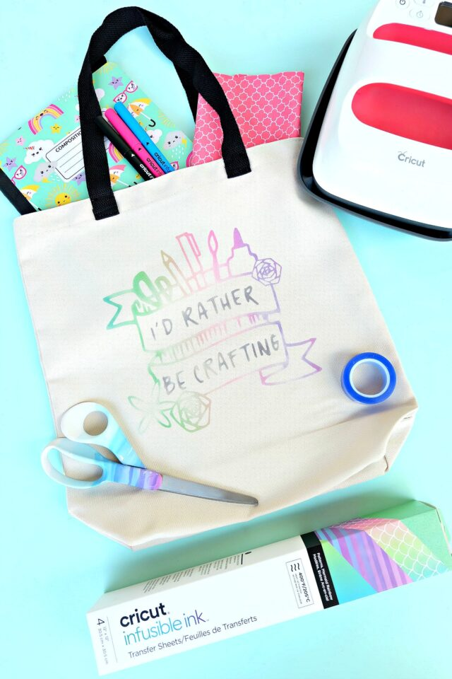 "Make a gorgeous rainbow ""watercolor"" craft tote bag using Cricut Infusible Ink! We're sharing all the tips and tricks that you need to know to use Cricut Infusible Ink! Follow along as we share step by step instructions for this fun and easy craft project! #CricutMade #crafting #infusibleink #sponsored"