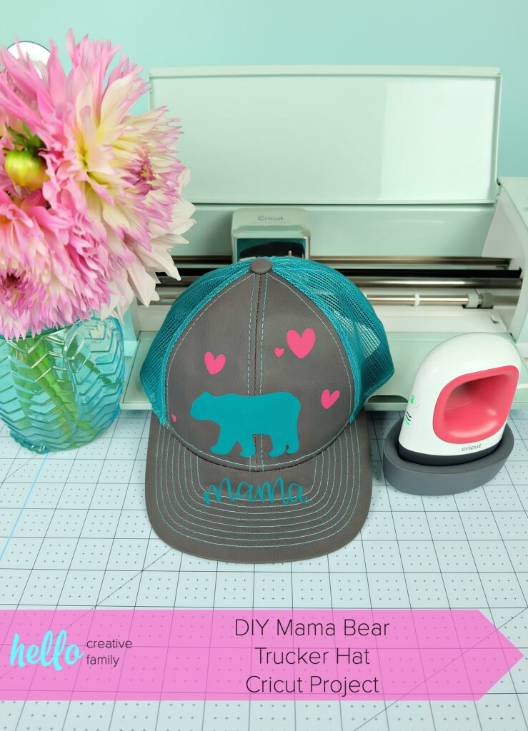 Make a DIY Mama Bear Trucker Hat using your Cricut with our easy step by step instructions! The perfect handmade gift for moms, new mamas and mommies to be! So fun to wear camping and in the great outdoors! An easy project for the Cricut Maker or Cricut Explore! #CricutCreated #CricutMade #DIYCamping #MomGift #Sponsored