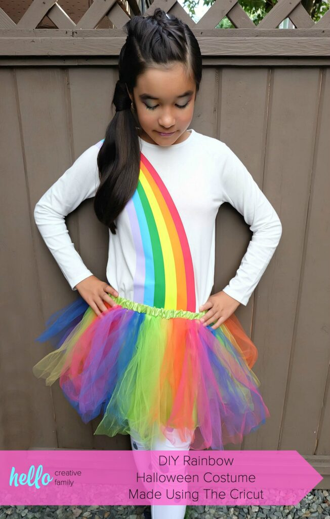 Create an Easy DIY Rainbow Halloween Costume out of leggings and a white shirt using your Cricut Maker or Cricut Explore Air 2! It's the perfect tween Halloween Costume idea! We're sharing step by step photos and the cut file to create this costume at home! #Cricut #DIYHalloween #HalloweenCostume #Rainbow #CricutCreated #Sponsored