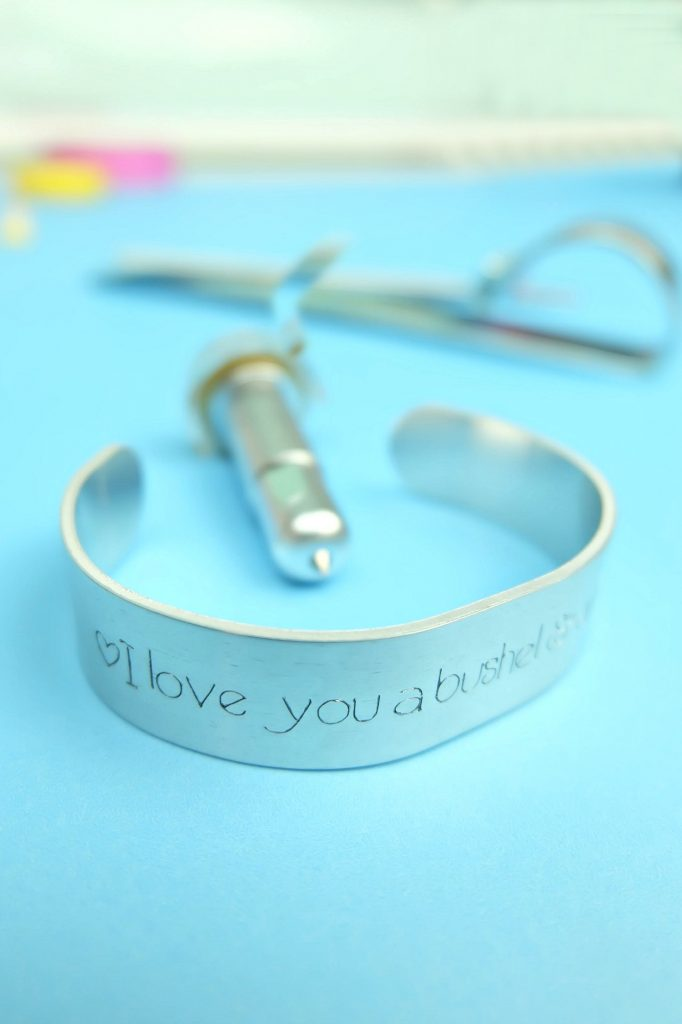 Learn how to use your Cricut Maker to engrave and make a pretty DIY Engraved Quote Bracelet in 10 minutes or less. A beautiful and easy personalized handmade gift idea. #CricutCreated #CricutMade #DIYJewelry #HandmadeGift