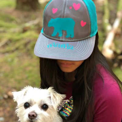 Make a DIY Mama Bear Trucker Hat using your Cricut with our easy step by step instructions! The perfect handmade gift for moms, new mamas and mommies to be! So fun to wear camping and in the great outdoors! An easy project for the Cricut Maker or Cricut Explore using the Cricut EasyPress Mini! #CricutCreated #CricutMade #DIYCamping #MomGift #Sponsored