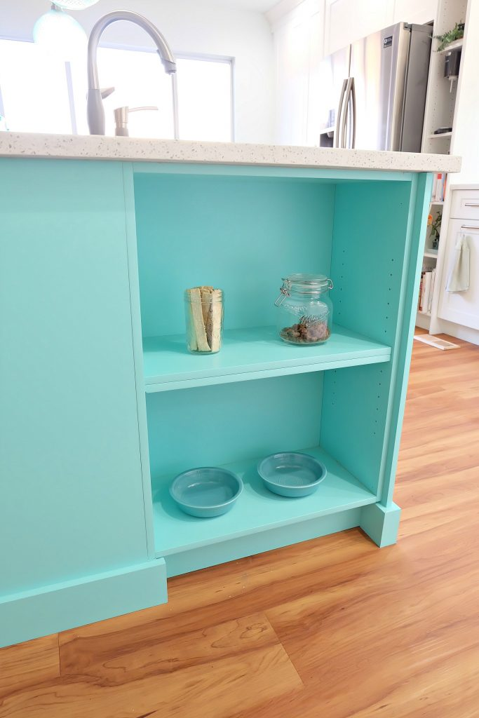 This sweet little shelf tucked into the side of a kitchen island is the perfect place to feed your pet and is a great pet friendly idea for a kitchen renovation. #Petfriendly #kitchenrenovation