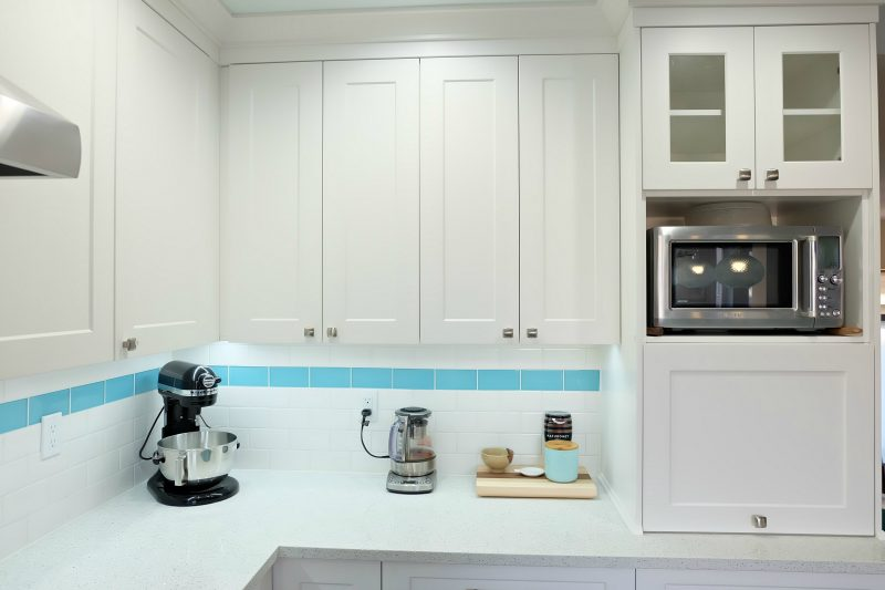 Get those appliances off the countertop and tucked away hidden with an appliance garage! Hello Creative Family selected a palette of white, grey, teal, turquoise and aqua for their kitchen renovation! This DIY teal kitchen remodel includes a colorful island and other smart features. Also check out her 20 Tips for a Smooth Kitchen Renovation! #Sponsored #Turquoise #Kitchen #Aqua #KitchenRemodel #kitchenrenovation