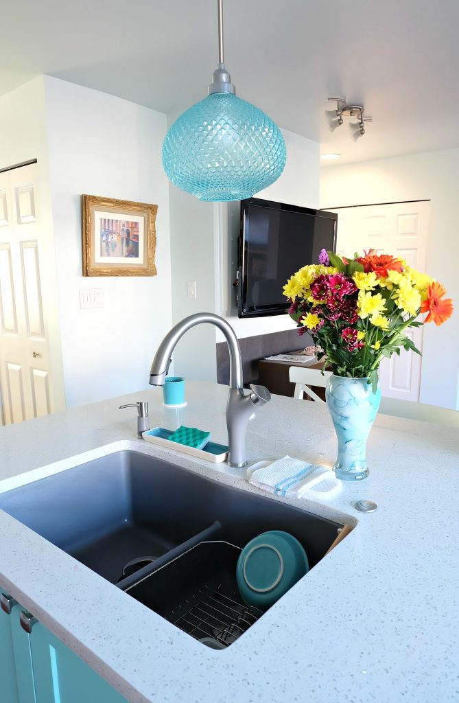 Pulling together a great kitchen renovation is all in the details! Hello Creative Family shares how she combined turquoise, aqua, white and grey elements to pull together a beautiful kitchen remodel including a teal kitchen island and a metallic grey Blanco Silgranit sink! #Sponsored #KitchenRenovation #KitchenRemodel #Turquoise #Teal #Aqua #kitchen