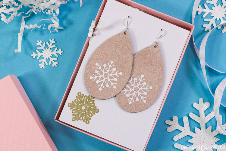 27 Cricut Gift Ideas That Take 1 Hour Or Less To Make: Leather Snowflake Earrings from That's What Che Said