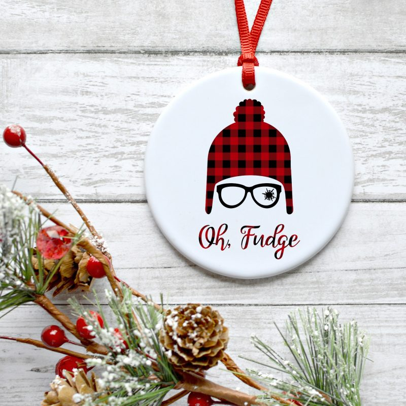"We're sharing a free A Christmas Story SVG file with one of our favorite movie lines ""Oh Fudge"". Find this cut file along with 15 other Christmas cut files to cut with your Cricut Maker, Cricut Explore or Silhouette! Makes the cutest DIY A Christmas Story Ornament! #Cricut #Christmas #AChristmasStory #FreeSVG"