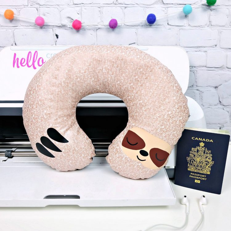 Would you believe that this adorable DIY Sloth Travel Pillow takes just 20 minutes to make using your Cricut Maker? It makes the cutest quick and easy handmade gift! Whip up a batch of them for a family who loves to travel. Includes a free sloth SVG cut file and step by step Cricut sewing instructions. #Sloth #CricutMade #CricutCreated #Travel #TravelAccessories #Sewing