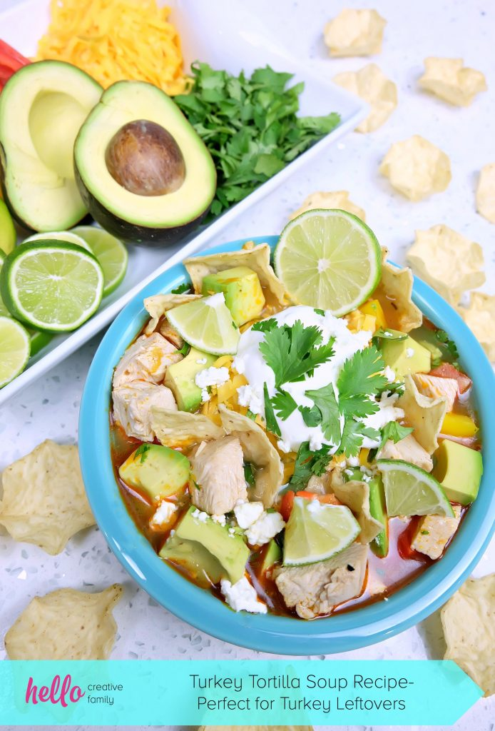 Take those Christmas or Thanksgiving Turkey Leftovers and turn them into an incredibly delicious and healthy meal your family will love with this Turkey Tortilla Soup Recipe! Perfect to warm you up on a cool day! #Sponsored #Turkey #Soup #Recipe #TurkeyTraditions