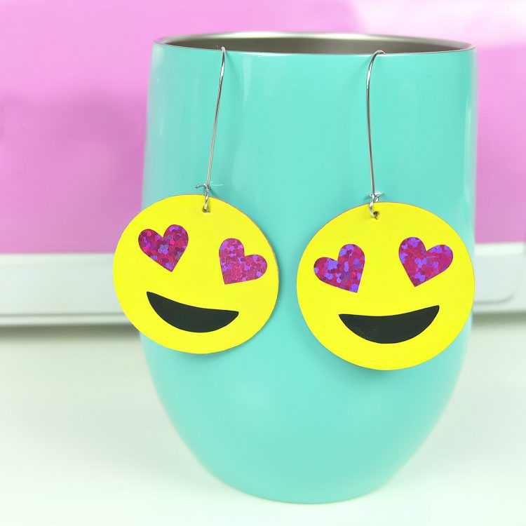 Learn how to make DIY earrings using your Cricut or Silhouette! We are sharing 12 free earring cut files including an SVG for heart eye emoji earrings! Includes step by step instructions! #CricutMade #FreeSVG #DIYEarrings #Crafts