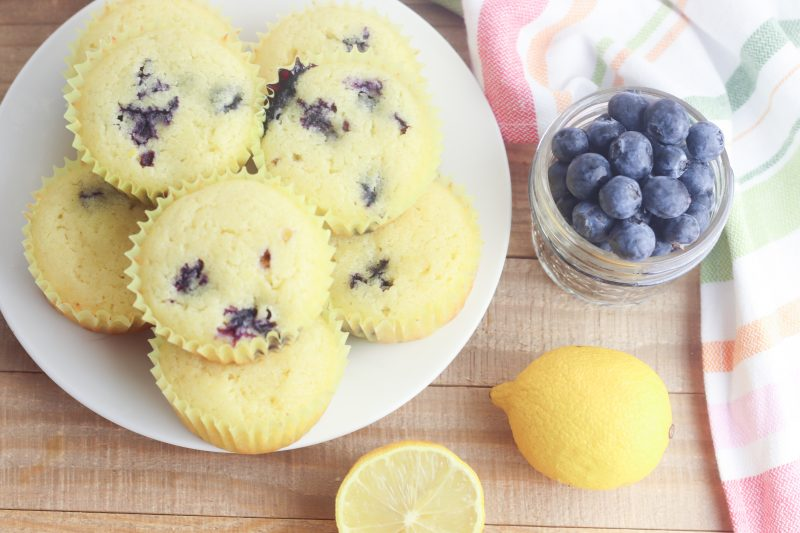 With the sweet burst of blueberries and tartness of lemons this gluten free lemon blueberry muffin recipe is easy and delicious! Takes just 5 minutes of prep and 25 minutes to bake which means hot muffins on the table in just 30 minutes! The perfect Mother's Day Breakfast Recipe! Who doesn't love an easy 30 minute muffin recipe? Includes substitutions for making with all purpose flour too. The perfect snack to satisfy a sweet tooth! #Baking #Recipe #Blueberry #lemon #BlueberryRecipes #Muffins #MothersDay #Breakfast